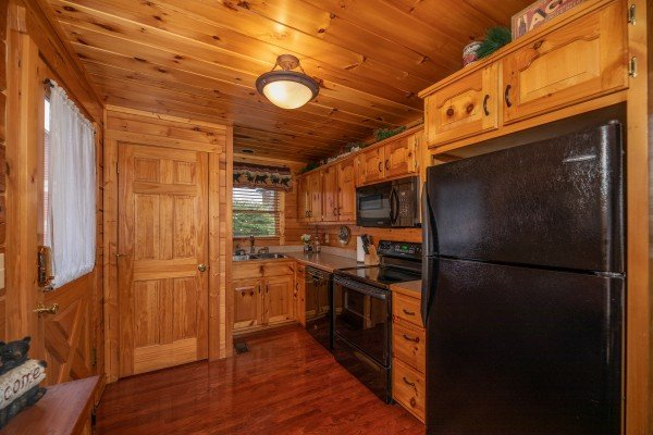 Kitchen with black appliances at 1 Above the Smokies, a 2 bedroom cabin rental located in Pigeon Forge