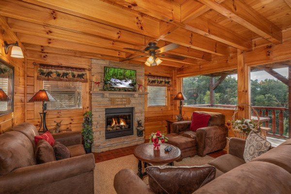 Fireplace and TV in the living room at 1 Above the Smokies, a 2 bedroom cabin rental located in Pigeon Forge