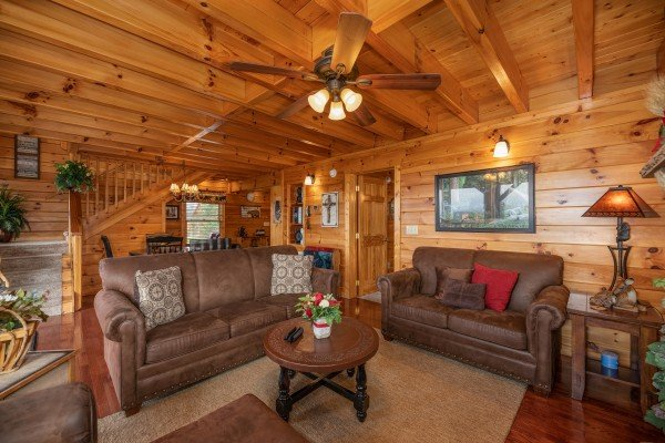 Living room with sofa and loveseat at 1 Above the Smokies, a 2 bedroom cabin rental located in Pigeon Forge