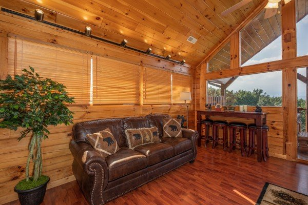 Sofa and bar set in the game loft at 1 Above the Smokies, a 2 bedroom cabin rental located in Pigeon Forge