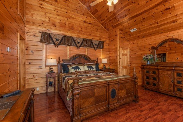 Bedroom with a king bed, two end tables, lamps, and a dresser at 1 Above the Smokies, a 2 bedroom cabin rental located in Pigeon Forge