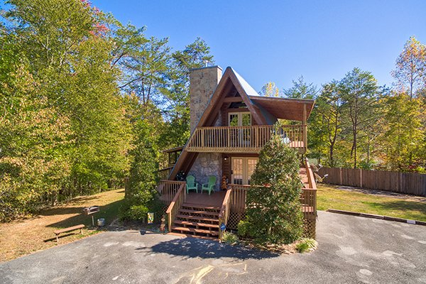 Looking back at the cabin and large gravel parking area at Living on Love, a 2 bedroom cabin rental located in Pigeon Forge