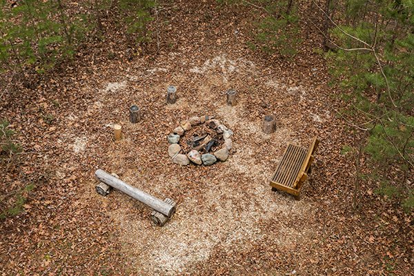 Looking down at the fire pit at Rising Wolf Lodge, a 3 bedroom cabin rental located in Pigeon Forge