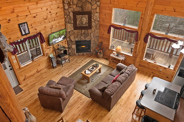 Looking down into the living room at Rising Wolf Lodge, a 3 bedroom cabin rental located in Pigeon Forge