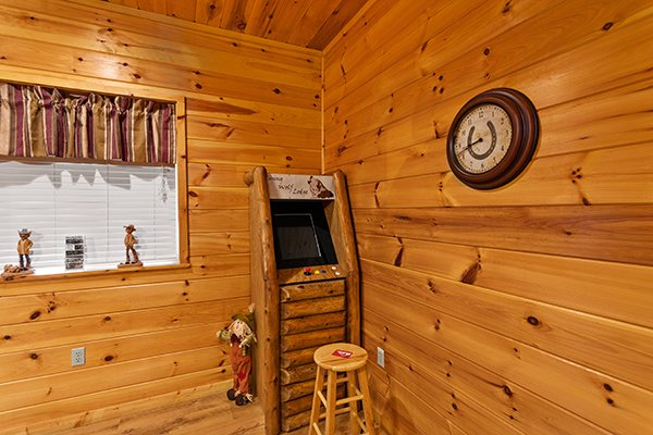 Arcade game in the corner at Rising Wolf Lodge, a 3 bedroom cabin rental located in Pigeon Forge
