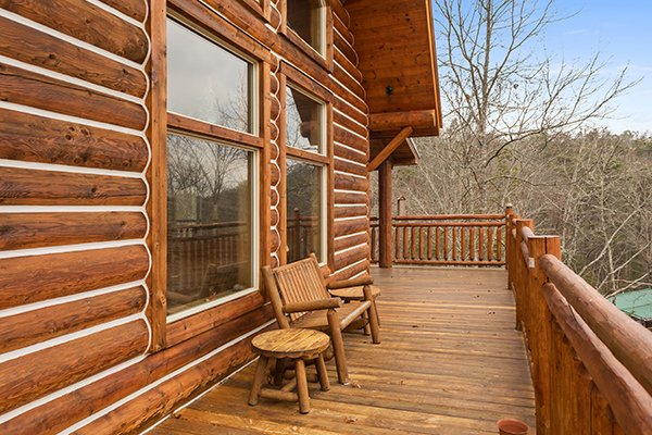 Log bench on the deck at Rising Wolf Lodge, a 3 bedroom cabin rental located in Pigeon Forge