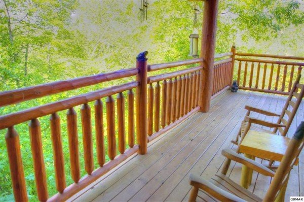 Looking into the woods from the deck at Rising Wolf Lodge, a 3 bedroom cabin rental located in Pigeon Forge