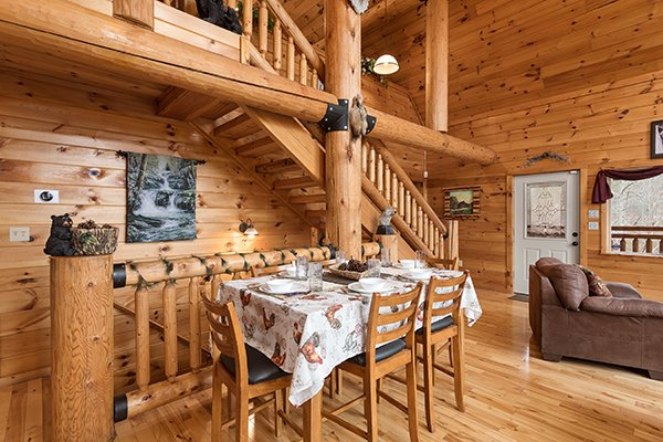 Dining table for six at Rising Wolf Lodge, a 3 bedroom cabin rental located in Pigeon Forge