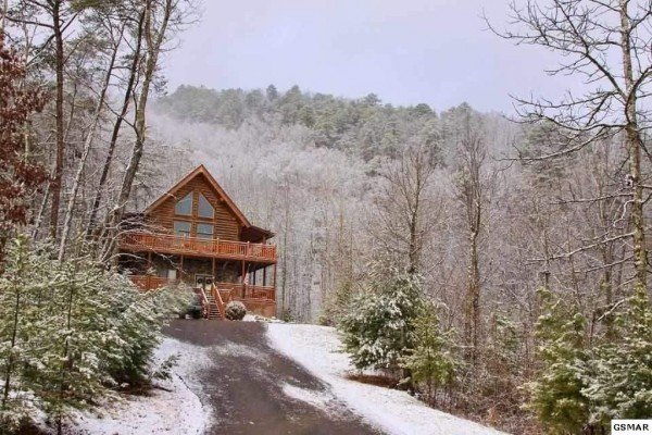 Snow surrounds Rising Wolf Lodge, a 3 bedroom cabin rental located in Pigeon Forge
