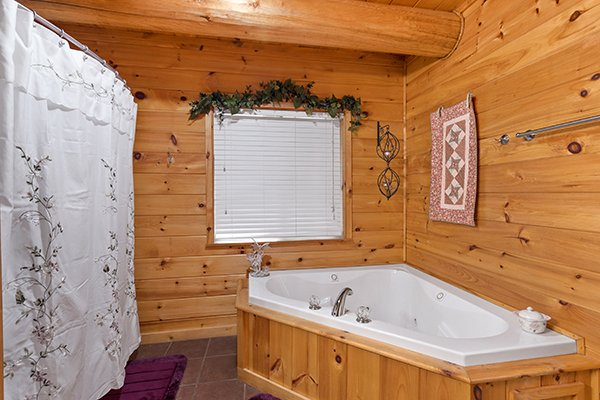 Corner jacuzzi tub at Rising Wolf Lodge, a 3 bedroom cabin rental located in Pigeon Forge
