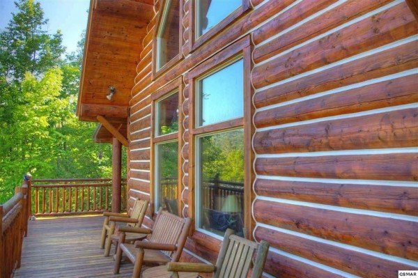 Log furniture on the deck at Rising Wolf Lodge, a 3 bedroom cabin rental located in Pigeon Forge