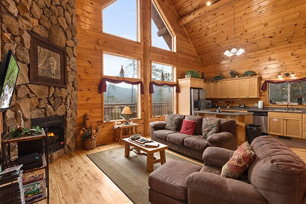 Open concept great room with living room and kitchen space at Rising Wolf Lodge, a 3 bedroom cabin rental located in Pigeon Forge