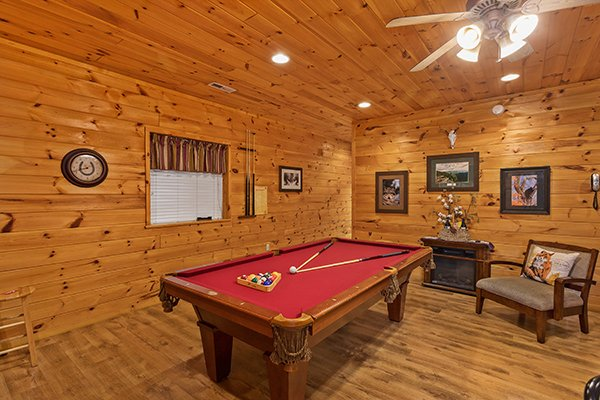 Pool table in the first floor game room at Rising Wolf Lodge, a 3 bedroom cabin rental located in Pigeon Forge