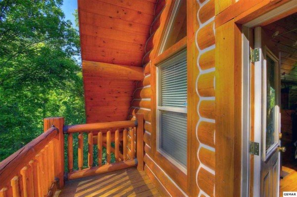 Deck off the loft space at Rising Wolf Lodge, a 3 bedroom cabin rental located in Pigeon Forge