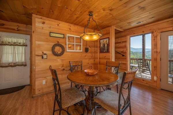 Dining room seating for four at A Perfect Getaway, a 3 bedroom cabin rental located in Pigeon Forge