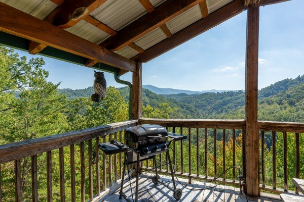 Grill on a covered deck at A Perfect Getaway, a 3 bedroom cabin rental located in Pigeon Forge