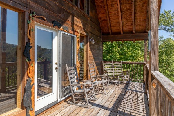 Loft deck with rocking chairs at A Perfect Getaway, a 3 bedroom cabin rental located in Pigeon Forge
