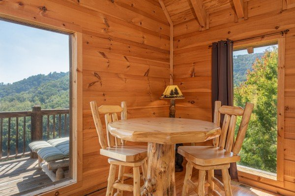 High top table in the loft at A Perfect Getaway, a 3 bedroom cabin rental located in Pigeon Forge