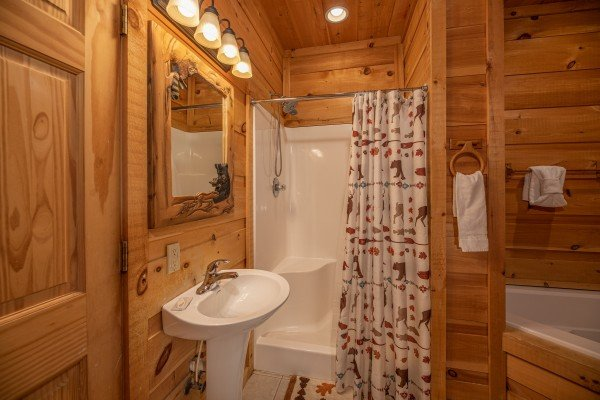 Bathroom with a corner jacuzzi at A Perfect Getaway, a 3 bedroom cabin rental located in Pigeon Forge
