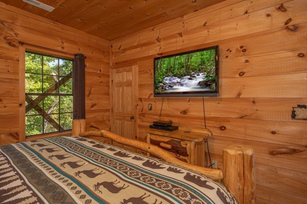 TV and dresser in the lower bedroom at A Perfect Getaway, a 3 bedroom cabin rental located in Pigeon Forge