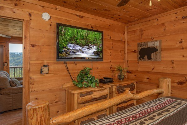 TV and dresser in the main floor bedroom at A Perfect Getaway, a 3 bedroom cabin rental located in Pigeon Forge