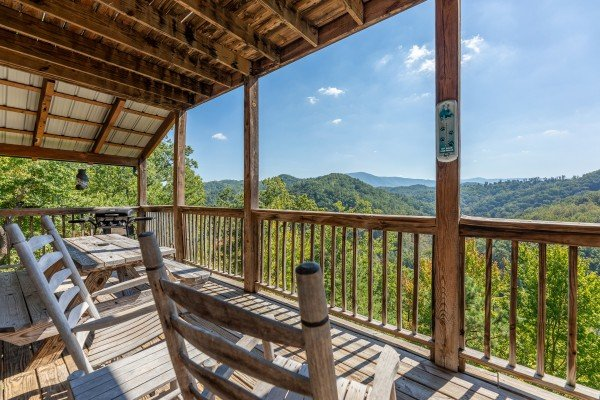 Mountain views from the covered deck at A Perfect Getaway, a 3 bedroom cabin rental located in Pigeon Forge