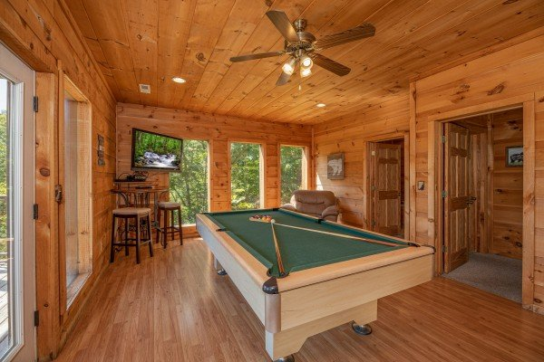 Pool table in the game room at A Perfect Getaway, a 3 bedroom cabin rental located in Pigeon Forge