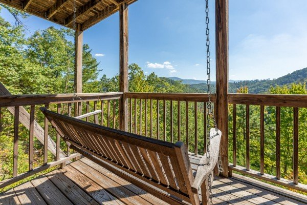 Porch swing with mountain views at A Perfect Getaway, a 3 bedroom cabin rental located in Pigeon Forge