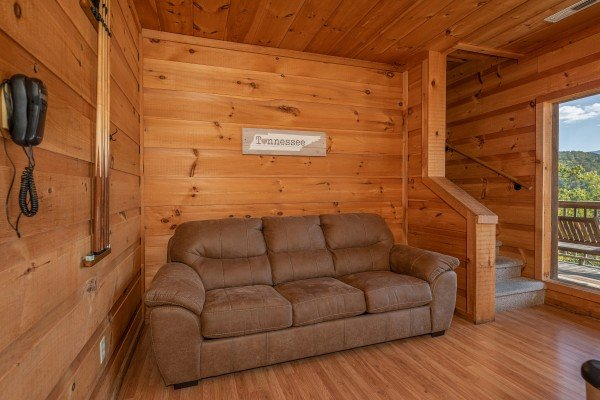 Sofa bed in the game room at A Perfect Getaway, a 3 bedroom cabin rental located in Pigeon Forge
