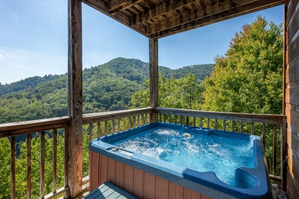 Hot tub and mountain view at A Perfect Getaway, a 3 bedroom cabin rental located in Pigeon Forge