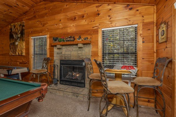 Checker table next to the fireplace at Hidden Pines, a 2-bedroom cabin rental located in Pigeon Forge