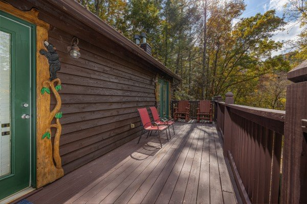 Deck with two chairs at Hidden Pines, a 2-bedroom cabin rental located in Pigeon Forge