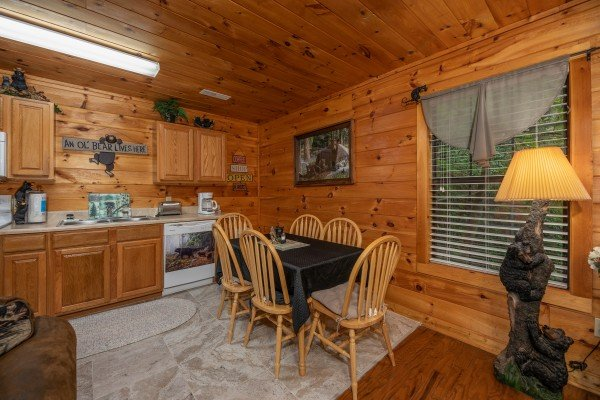 Kitchen and dining space at Hidden Pines, a 2-bedroom cabin rental located in Pigeon Forge