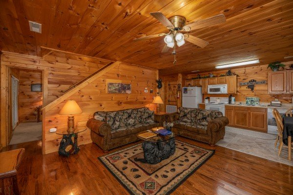 Living room and kitchen at Hidden Pines, a 2-bedroom cabin rental located in Pigeon Forge