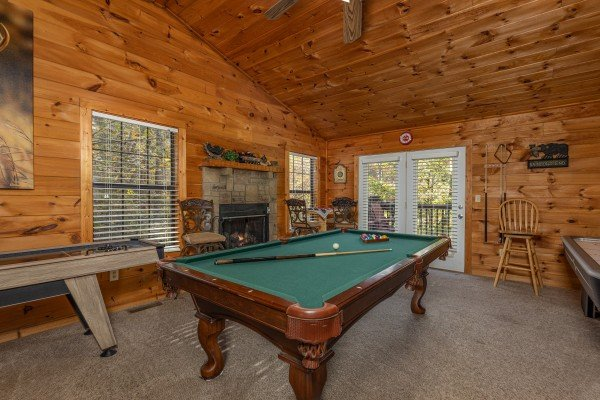 Pool table in the game room at Hidden Pines, a 2-bedroom cabin rental located in Pigeon Forge