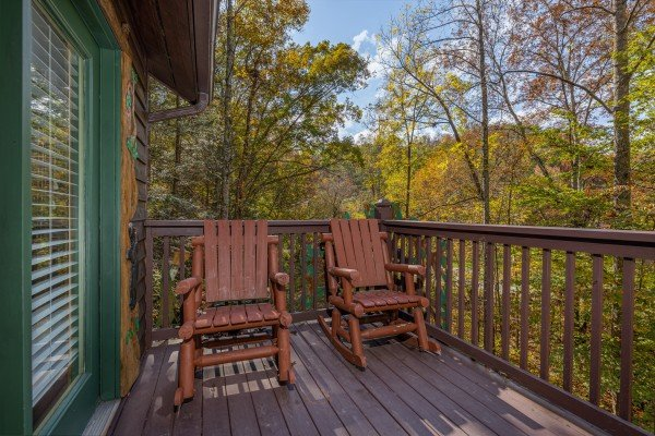 Rocking chairs on the deck at Hidden Pines, a 2-bedroom cabin rental located in Pigeon Forge