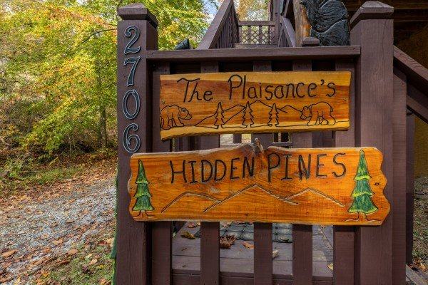 Welcome sign at Hidden Pines, a 2-bedroom cabin rental located in Pigeon Forge