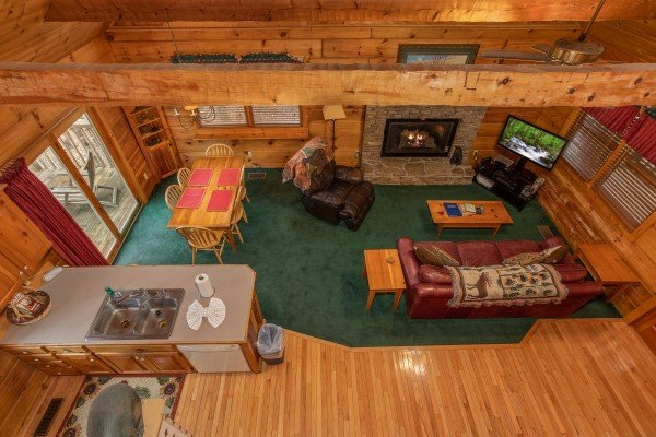 Looking down onto the main floor at Sweet Mountain Escape, a 2 bedroom cabin rental located in Pigeon Forge
