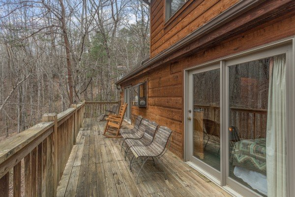 Deck seating at Sweet Mountain Escape, a 2 bedroom cabin rental located in Pigeon Forge