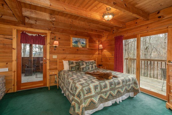 Bedroom with king bed and deck access at Sweet Mountain Escape, a 2 bedroom cabin rental located in Pigeon Forge