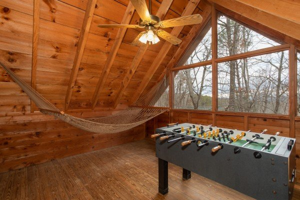 Hammock and foosball in the game loft at Sweet Mountain Escape, a 2 bedroom cabin rental located in Pigeon Forge