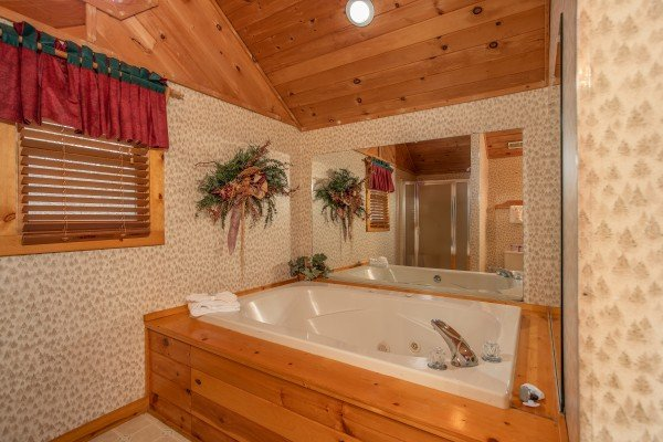 Jacuzzi off the upstairs bedroom at Sweet Mountain Escape, a 2 bedroom cabin rental located in Pigeon Forge