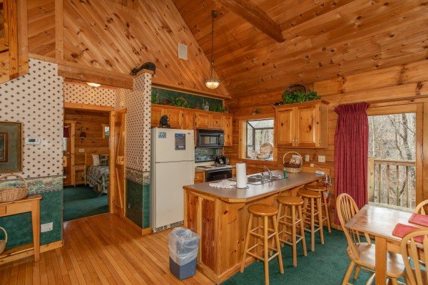 Kitchen with breakfast bar at Sweet Mountain Escape, a 2 bedroom cabin rental located in Pigeon Forge