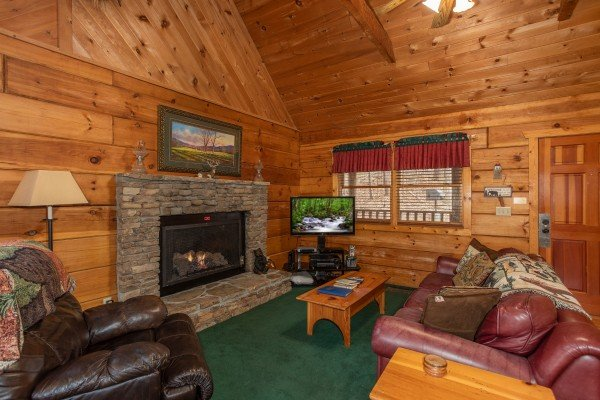 Living room with fireplace and TV at Sweet Mountain Escape, a 2 bedroom cabin rental located in Pigeon Forge
