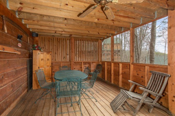 Porch with dining set for four at Sweet Mountain Escape, a 2 bedroom cabin rental located in Pigeon Forge