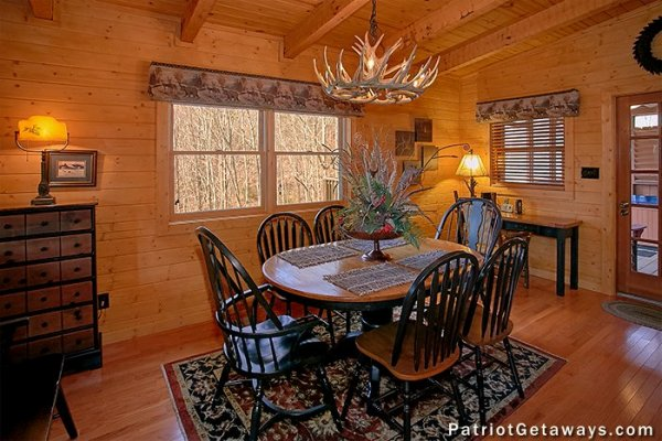 Dining space with seating for six at Stags Leap, a 2 bedroom cabin rental located in Pigeon Forge