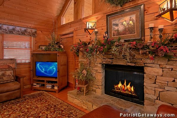 Close up shot of TV and fireplace at Stags Leap, a 2 bedroom cabin rental located in Pigeon Forge