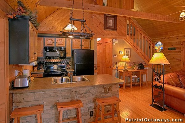 Kitchen with black appliances at Stags Leap, a 2 bedroom cabin rental located in Pigeon Forge