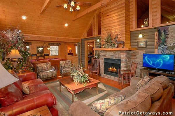 Living room with fireplace and TV at Stags Leap, a 2 bedroom cabin rental located in Pigeon Forge
