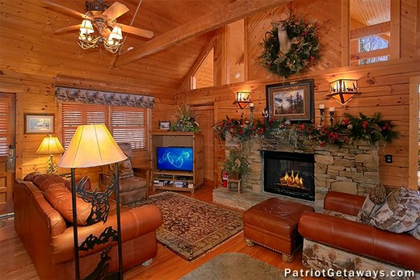 Living room with TV and fireplace at Stags Leap, a 2 bedroom cabin rental located in Pigeon Forge
